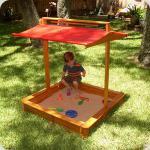 Детская песочница с крышкой - актуальный вариант для природы