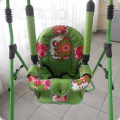 Качель з бампером Sofia (зелений з червоним в квітка)